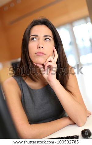 Office worker with upset look on her face - stock photo