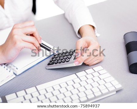 Office worker woman calculating with calculator