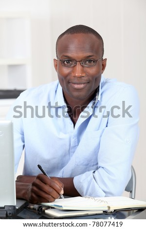Office worker writing on agenda - stock photo