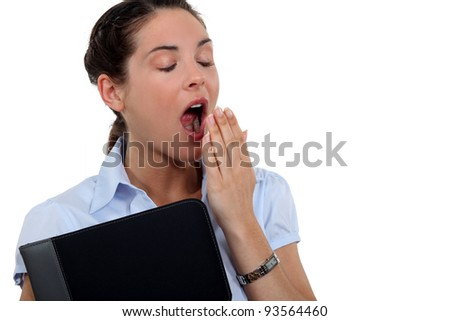 Office worker yawning