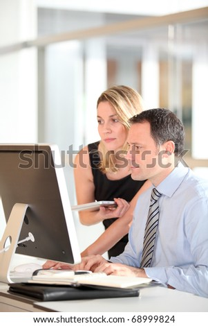 Office workers in front of computer