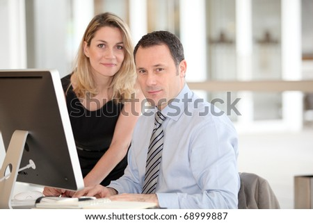 Office workers in front of computer - stock photo