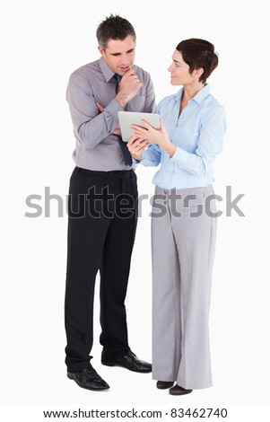 Office workers looking at tablet computer against a white background