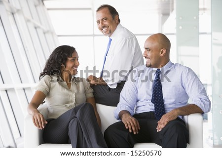Office workers meeting lobby area - stock photo
