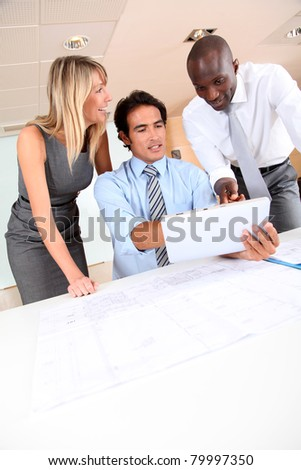 Office workers meeting with electronic tablet - stock photo
