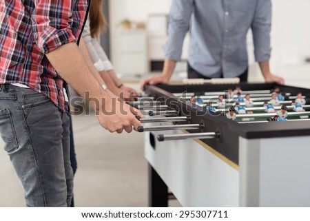 Office Workers Playing an Indoor Soccer World Cup Game During their Break Time to Relieve Stress. - stock photo