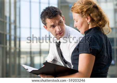 Office workers sign document outdoor - stock photo