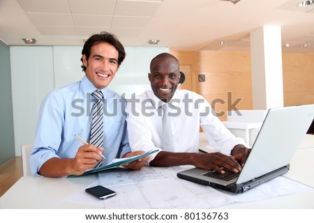 Office workers with laptop computer - stock photo
