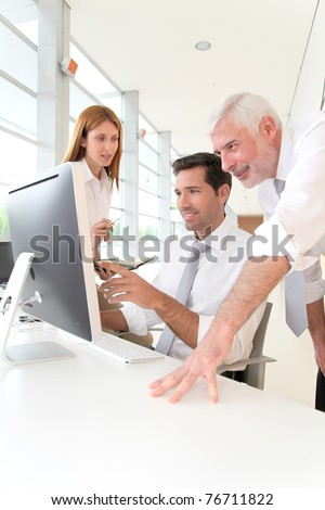 Office workers with manager in a meeting - stock photo