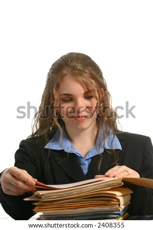 Office working looking at files with pleasant expression - stock photo