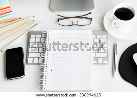 Office workplace with computer on white table. Top view - stock photo