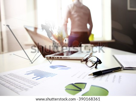 Office workplace with laptop and smart phone on wood table - stock photo
