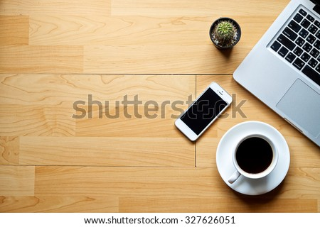 Office workplace with laptop coffee of cup and smartphone on wood table.  - stock photo