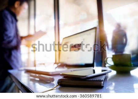 Office workplace with laptop in morning light. - stock photo