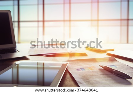 Office workplace with laptop on wood table against the windows. - stock photo
