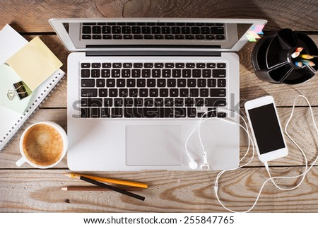 Office workplace with laptop on wooden table - stock photo
