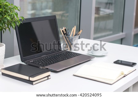 Office workplace with notebook on wood table. - stock photo