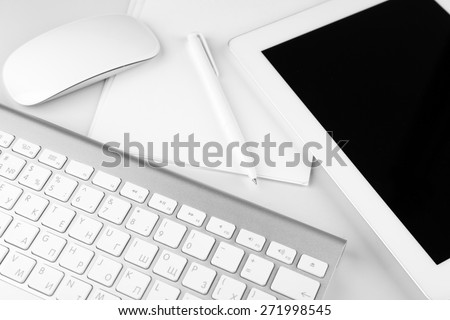 Office workplace with tablet and computer close up - stock photo