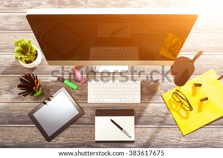 Office workplace with tablet and pc on wood table. - stock photo