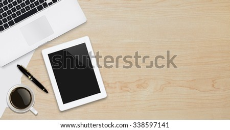 Office workplace with text space ,Wooden table with office supplies tablet,laptop and coffee cup, top view