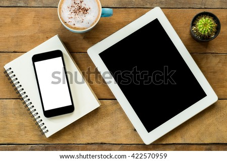 Office workspace with blank screen tablet, blank screen smartphone,coffee cup  and notebook.Top view with copy space - stock photo