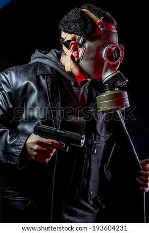 Officer, Private detective with bulletproof vest and gas mask - stock photo