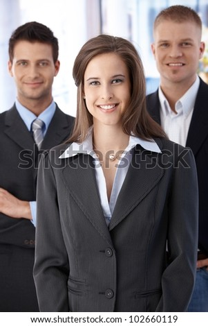 Official business team portrait, confident, smiling businesspeople standing in office. - stock photo