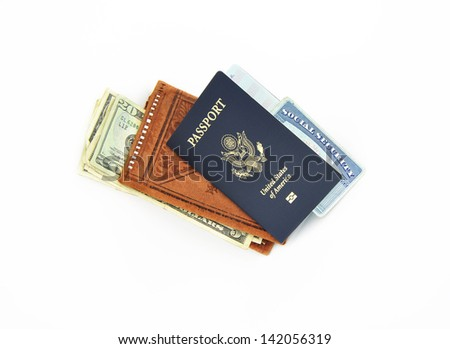 Official 2013 Passport booklet United States of America with leather wallet US Dollars and Social Security Card isolated on white background - stock photo