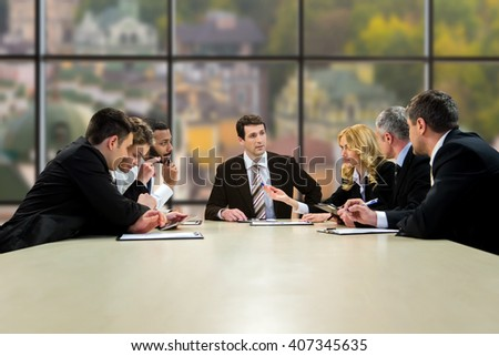 Official people sitting and talking. Midday conference in company's headquarters. Best employees of analytical department. Time for the next step. - stock photo