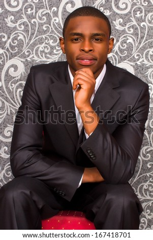 Official portrait of black young man - stock photo