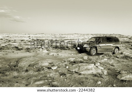 Offroad SUV in Utah desert - stock photo
