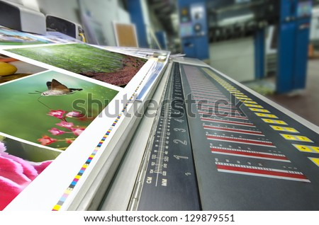 offset machine press fountain control key unit and cmyk stripe - stock photo
