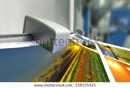 offset machine press print run at table, fountain key color management spectrophotometar control unit - stock photo