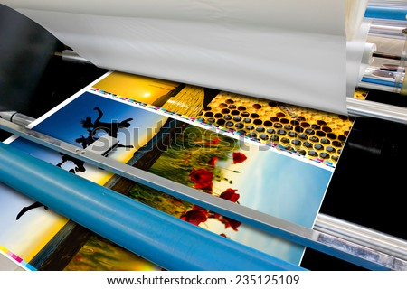 offset machine roll foil laminator detail - stock photo