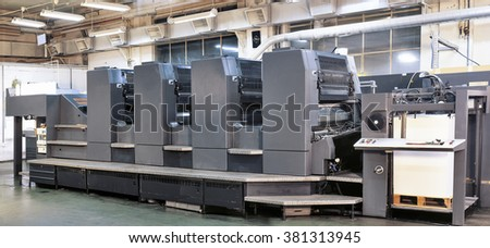 Offset printer press in industry plant - stock photo
