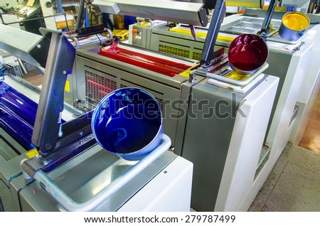 offset printing press and ink pot - stock photo
