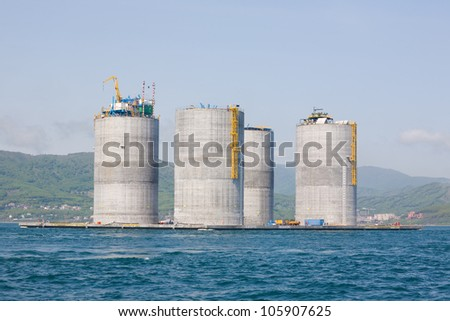 Offshore base oil drilling platform in a floating state. Sea of Japan. Russian coast. - stock photo