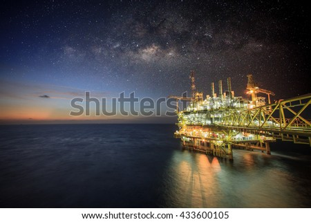 Offshore construction platform for production oil and gas, Oil and gas industry and hard work, Production platform and operation process by manual and auto function. Milky way background and galaxy. - stock photo