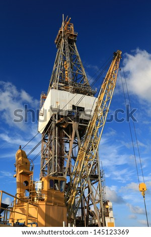 Offshore Drill Rig and Rig Crane with Blue Sky - stock photo