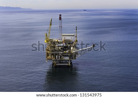 Offshore drilling platform, aerial view - stock photo
