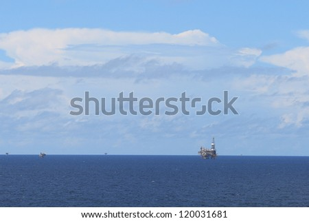 Offshore drilling rig and platforms in the offshore oil gas field - stock photo