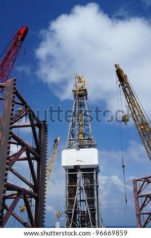 Offshore Drilling Rig (Jack Up Rig) With Rig Cranes on Sunny Day - The View From The Bow Leg of The Rig