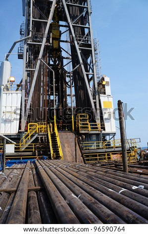 Offshore Drilling Rig (Jack Up) With Casing Laying On The Deck - stock photo