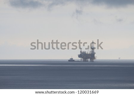 Offshore Jack Up Drilling Rig in Rainy Day - stock photo