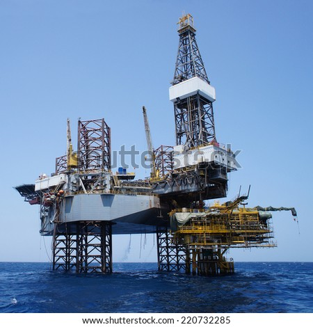 Offshore Jack Up Drilling Rig Over The Production Platform in The Middle of The Sea - Square Shape              - stock photo