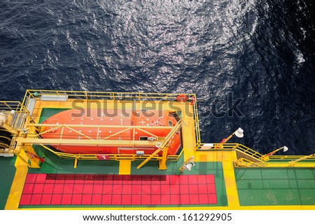 Offshore life boat station at an oil and gas platform in the Gulf of Thailand - stock photo