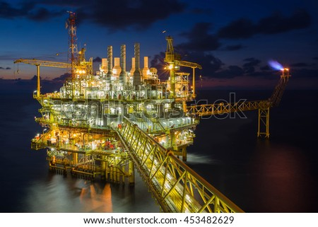 Offshore oil and gas industry in the gulf of Thailand, Oil and Gas central processing platform and flare platform in twilight scene.  - stock photo