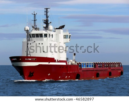 Offshore oil and gas platform supply vessel underway at sea. - stock photo