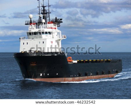 Offshore oil and gas platform supply vessel underway to oil rigs. - stock photo