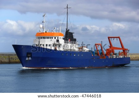 Offshore oil and gas research vessel underway in port channel. - stock photo